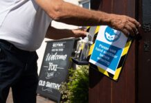 A landlord installs a hand sanitising station outside his pub