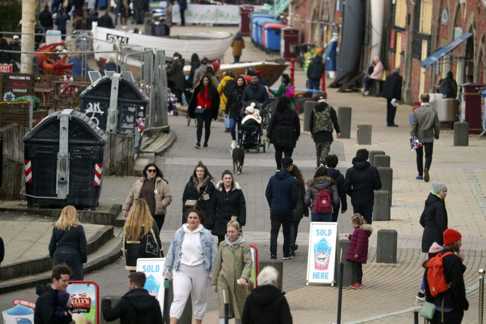 Spring People walk along the seafront in Brighton, East SussexApr 2nd 2021